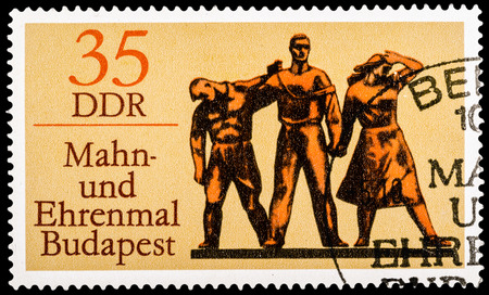 fascism: GDR - CIRCA 1976: A stamp printed in GDR shows Monument in Budapest - In Memory of the Victims of Fascism, circa 1976 Editorial