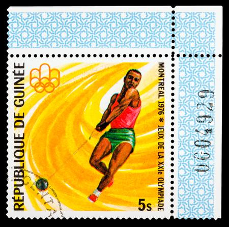 guinee: REPUBLIQUE DE GUINEE - CIRCA 1976: A stamp printed in Republique de Guinee shows Summer Games in Montreal 1976, series sport, circa 1976