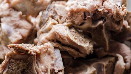 Beef boiled meat with bones. Background texture. Close-up