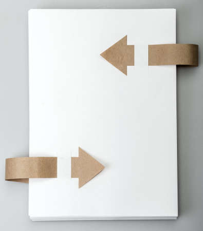 White paper with an arrow. Background texture