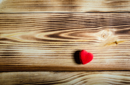 Happy Valentines Day. Red heart on wooden background. Love Stock Photo