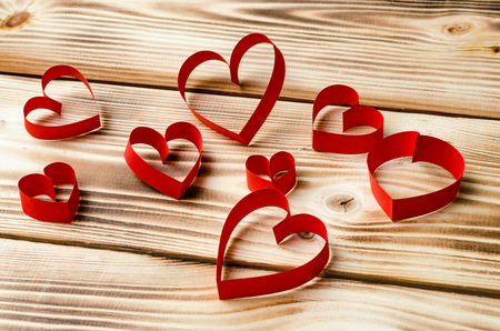 Happy Valentines Day. Hearts on a wooden background. Love. Celebratory background Stock Photo
