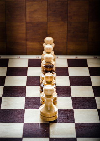 Chess pawn on the board. Background Stock Photo
