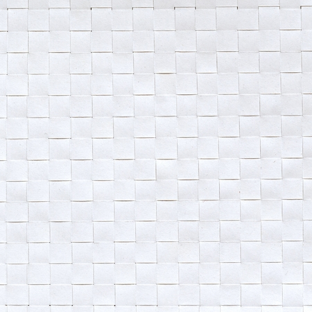 Textured sheet of white paper from squares, top view. Flat lay