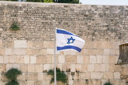 Israel-Flag in front of the Western Wall Stock Photo - 145126602
