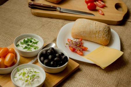 Vegetarian food with fresh tomatoes, olives and cheese. Stock Photo