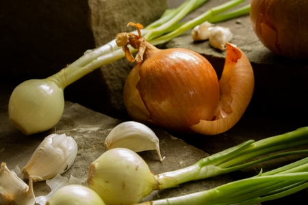 Garlic and onions, a composition of kitchen flavors.