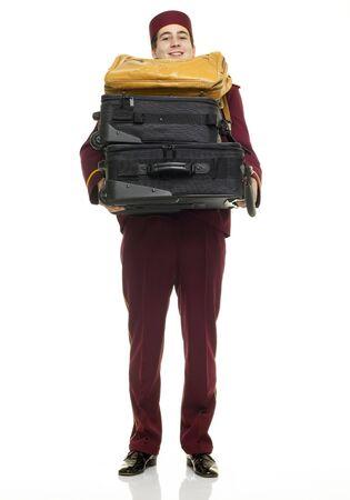 acomodador: El ujier con los guantes uniformes y blancos del rojo lleva bolsos y las maletas Foto de archivo