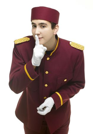 overseer: Usher with red uniform and white gloves keeps a secret and holds up a finger against his mouth. Stock Photo