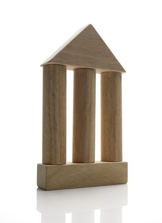 judiciary: A house made out of wooden toy blocks symbolize the three colums of democracy (execuitve, legislative, judiciary)