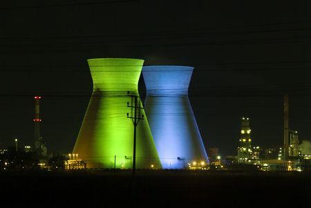 haifa: Israeli oil Refinery in Haifa by night illuminated in green and blue Stock Photo