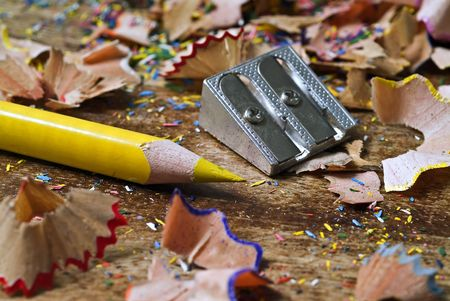 yellow pencil and multicolored shavings Stock Photo - 2558546