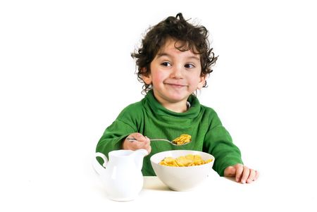 young boy eating cornflakes isolated on white Stock Photo