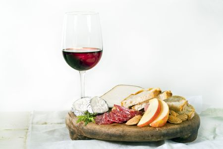 roquette: wine cheese bread and fruits on white Stock Photo