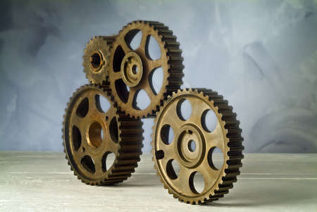 studio still life of four cog-wheels photo