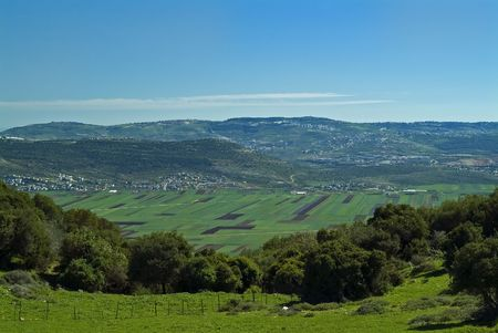 view of Beit Netofa valley in the Galilee, Israel, with Nazaret on the horizon Stock Photo - 2703815