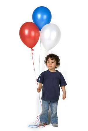 little boy holding 3 balloons photo
