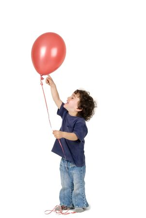 little boy holding red balloon photo