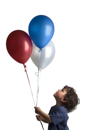 little boy holding red blue and white balloons