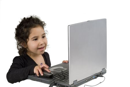 littel girl playing with laptop computer Stock Photo - 2733560