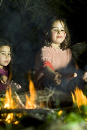 campfires: two girls having fun at a bonfire