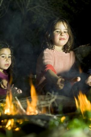 bonfire night: two girls having fun at a bonfire