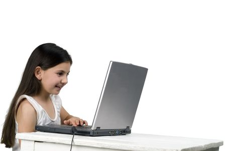 littel girl playing with laptop computer Stock Photo - 2759312