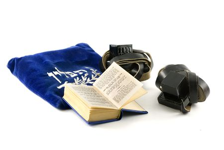 tefillin: Tefillin - phylacteries worn by Jewish men for morning prayers, Siddur - Jewish prayerbook and bag isolated on white  Stock Photo