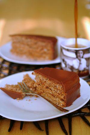 chocolate cake and coffee being poured into mug photo