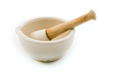 ceramic mortar and pestle isolated on white photo