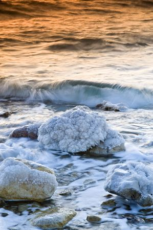sunrise over the dead sea with water in motion blur photo