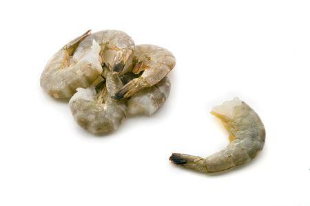 prepared shrimp: group of raw headless shrimps isolated on white