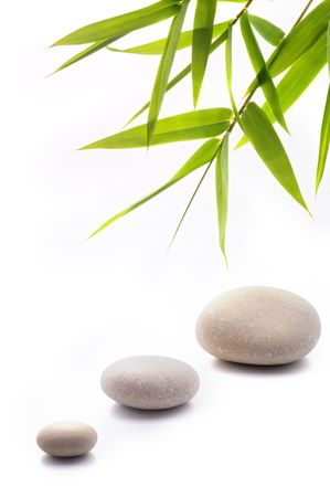 bamboo leavs and three stones isolated on white Stock Photo - 3198750