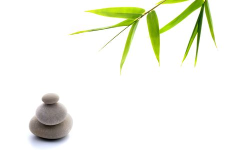 bamboo leavs and three stones isolated on white