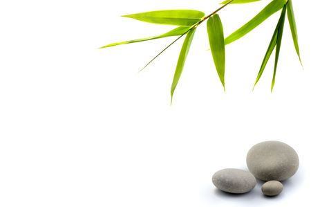 bamboo leavs and three stones isolated on white photo