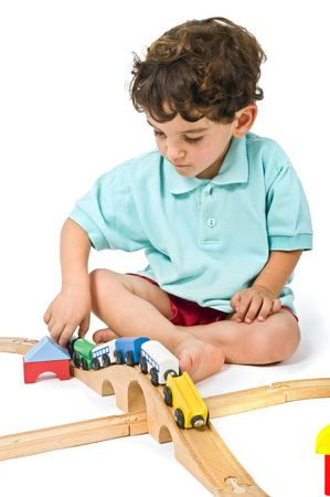 little boy playing with toy train isolated on white