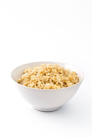 quinoa: bowl of cooked quinoa with onion isolated on white