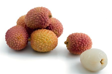 group of lychee and one peeled isolated on white photo