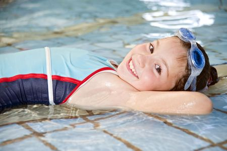 girl lying down in a swimming pool