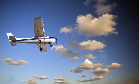 pilot light: small airplane in twilight Stock Photo