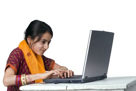 indian girl and laptop computer isolated on white
