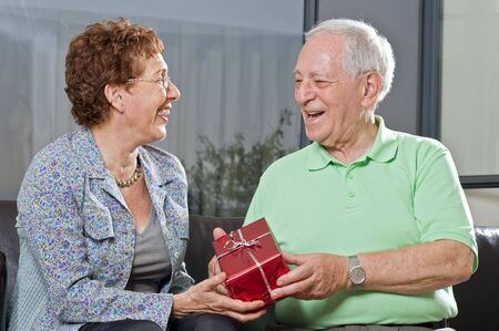 senior couple giving gift to each other Stock Photo - 3520909