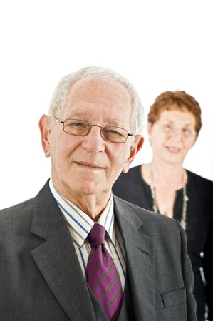 closeup  portrait off a senior businessman with colleague in the background isolated on white Stock Photo - 3527785