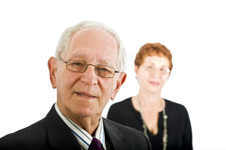closeup  portrait off a senior businessman with colleague in the background isolated on white photo