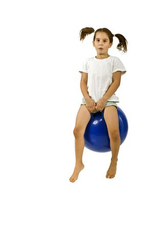 hopper: young girl on a  blue space hopper isolated on white