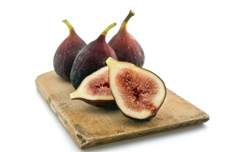 three whole figs and one sliced one isolated on white Stock Photo - 3560213