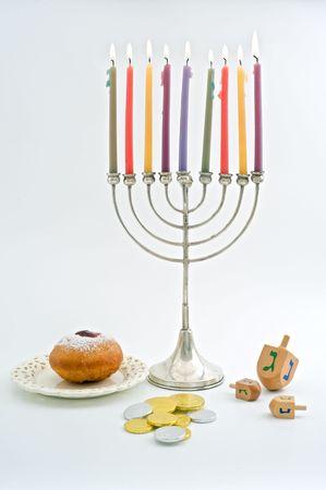 chanukiah: Hanukkah menora, Dreidel, Chocolate Gelt, donuts, over white