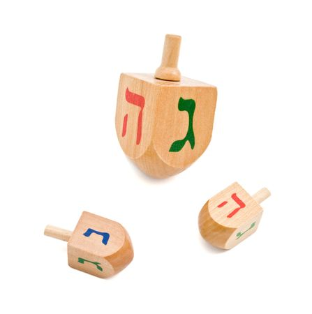hanukka: three wooden dreidel jewish hanukkah game isolated on white
