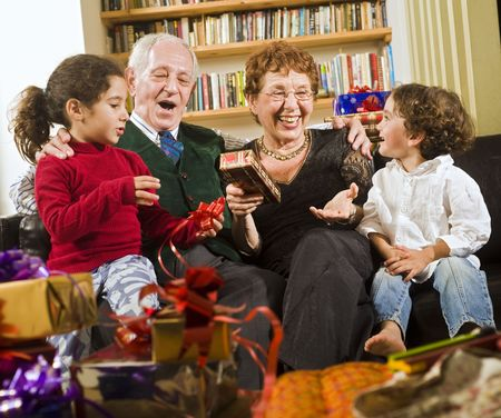grandparents grandchildren and presents Stock Photo