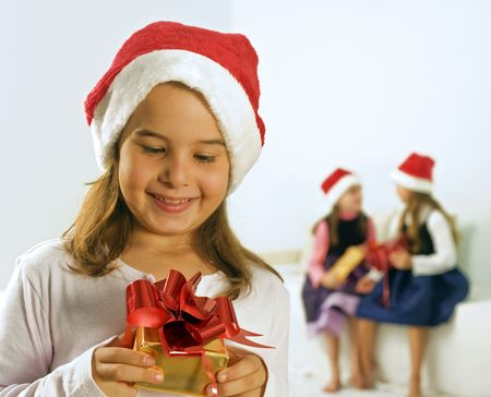 a little girl happy after reciving a present photo